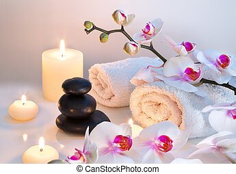 preparation for massage in white with towels, stones, ...