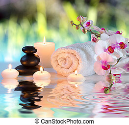 preparation for massage in white with towels, stones, in ...
