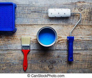 preparation for painting with can of blue paint top view -...