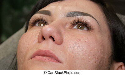 Preparation for permanent lip make-up. The face of a young woman with not tattooed lips