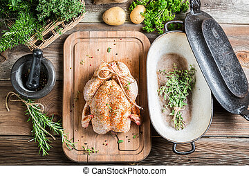 Preparation for roasting chicken with herbs