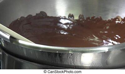 melting dark chocolate over a water bath