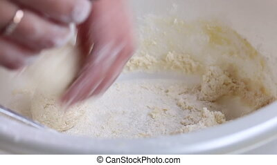 Preparation of cheese cakes. The woman forms the billets...