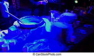 Preparation of dessert using liquid nitrogen in the bar