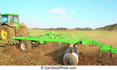 preparation of field tractor harvesting cultivation