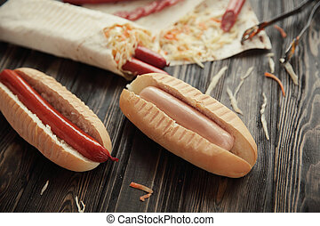 preparation of hot dogs with sausage.photo on a wooden backgroun
