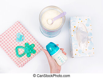 Preparation of mixture baby feeding with infant formula powdered milk in bottle
