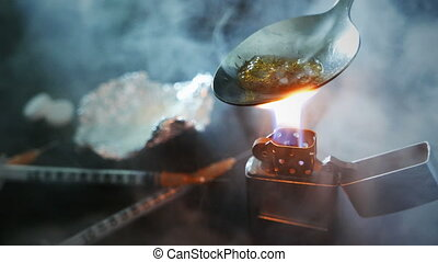 preparation of narcotic substance in the spoon on fire