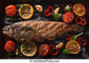Preparation of rainbow trout on the grill closeup. Horizontal top view