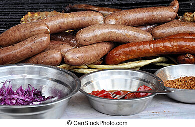 Preparation of roast grill sausages . Ingredients for sausages. Street food.