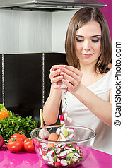 Preparation of salad in the kitchen