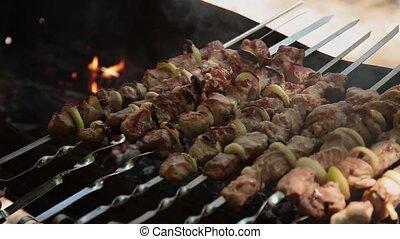 Preparation of shish kebab on charcoal, crisp on meat.