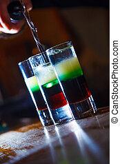 shot - Preparation of shots cocktails. Close-up