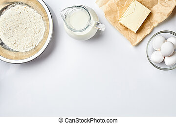 Preparation of the dough. A measurement of the amount of ingredients in the recipe. Ingredients for the dough: flour, eggs, milk, butter, cream. Top view, space for text. Still life. Flat lay