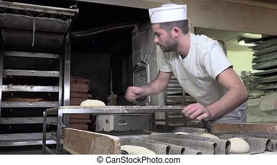 preparation of the french baguette - rolling and shaping...