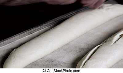 preparation of the french baguette - scarifying the bread...