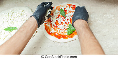 Preparation of traditional Neapolitan pizza.