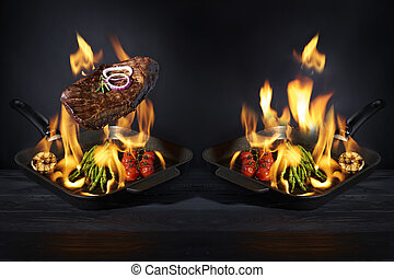 Preparation steak and vegetables in pan with fire flame on dark background. Restaurant and hotel service concept. Restaurant and hotel service concept.