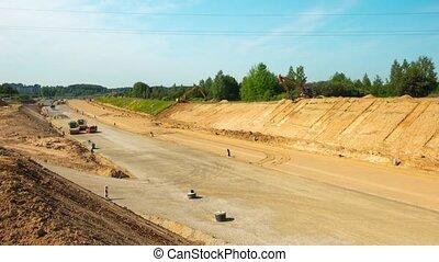 Preparatory work before asphalting on a large highway,...