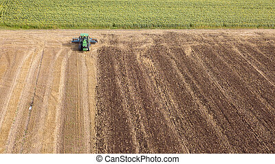 Preparatory work for sowing crops, cultivation of the soil by a tractor after harvesting.
