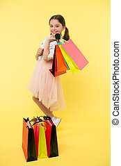 Prepare for school season buy supplies stationery clothes in advance. Great school shopping deals. Back to school season great time to teach budgeting basics children. Girl carries shopping bags