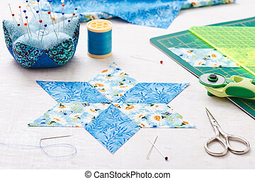 Prepare of diamond pieces of fabric for sewing quilt