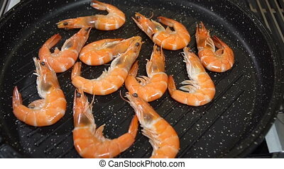 Prepare sea shrimps in a pan. Slow motion - Prepare sea...