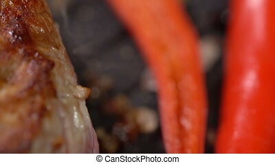 Prepare steak with hot peppers in a pan. slow motion - Cook...