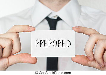 Prepared. Businessman in white shirt with a black tie showing or holding business card