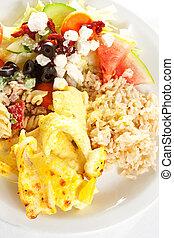 Prepared fish - A plate of fried fish with brown rice and ...