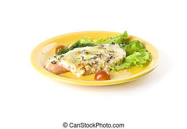 Prepared fish with salad on yellow plate