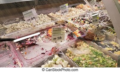 Prepared salads in the refrigerator - Seller sells...