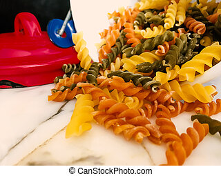prepares pasta in kitchen for food