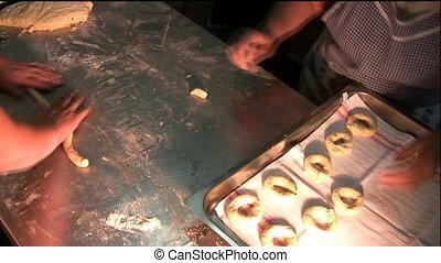 Preparig rings shaped - Two ladyes preparing rings shaped in...