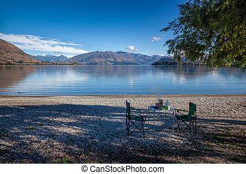 Preparing a breakfast picnic on the shore of Lake Wanaka