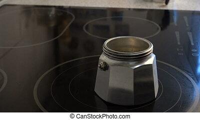 preparing a coffee with the geyser coffee maker - preparing...