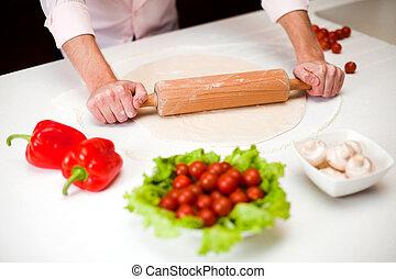 Preparing a dough for italian pizza close up