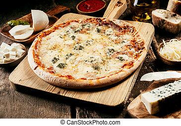Preparing a four cheeses Italian pizza