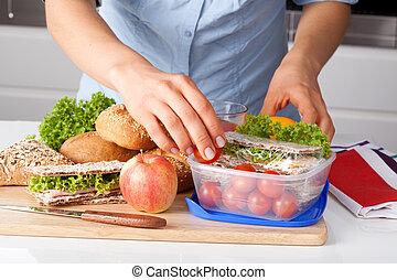 Preparing a lunch - Woman in blue t-shirt preparing a...