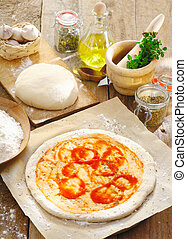 Preparing an Italian pizza