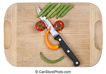 Preparing and cooking food with knife smiling vegetables face on