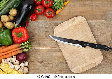 Preparing and slicing vegetables knife on cutting board