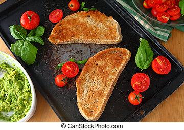 Preparing avocado toast with tomatoes