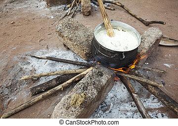 Preparing banku on a fire, Ghana, West Africa