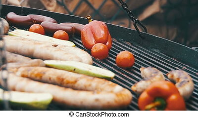 Preparing Barbecue Delicious Sausages and Vegetables on the Grill. Slow Motion
