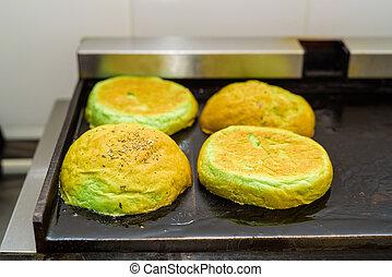 Preparing bun for hamburger