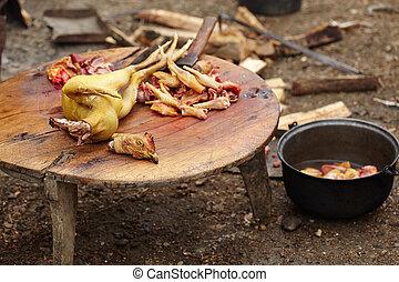Preparing chicken outdoor