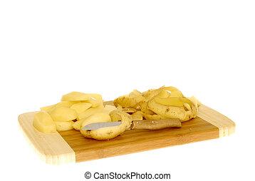 Preparing dinner, Peeling potatoes - Peeling potatoes,...