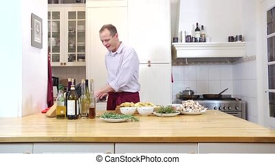 Preparing dinner - Zooming in on a hobby cook, preparing a...