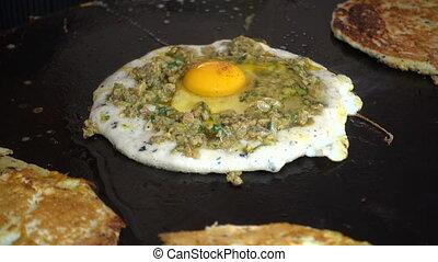 Preparing egg bara, a traditional Newari snack made of black...